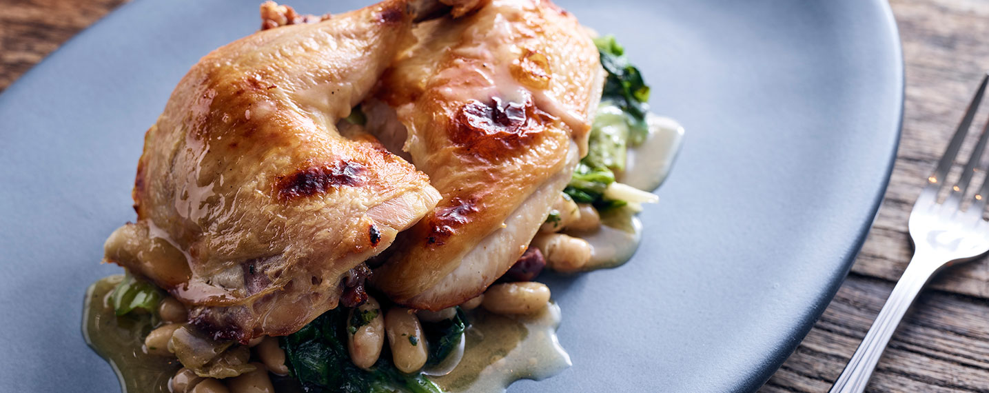 Roasted Chicken on a bed of beans and greens